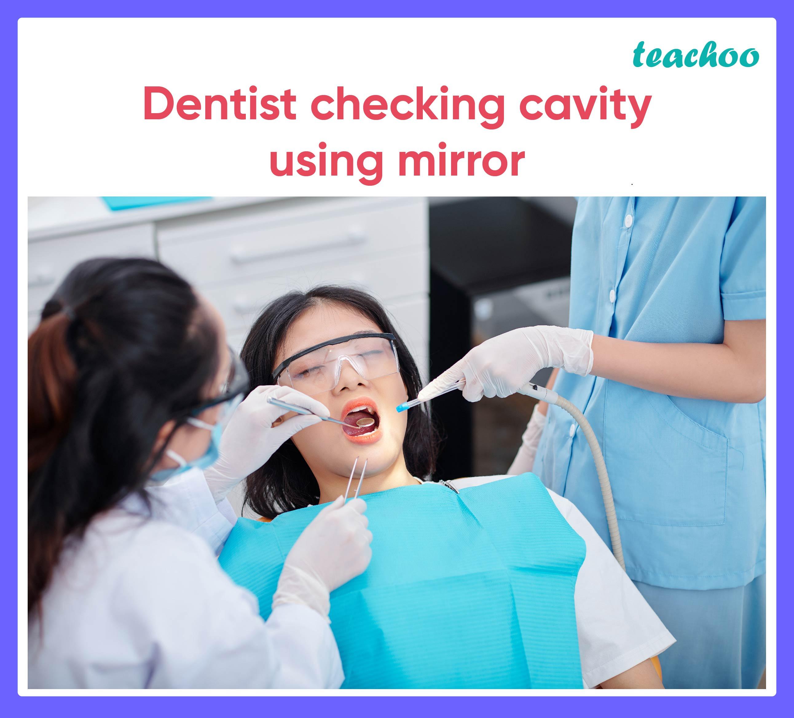 Dentist checking cavity using mirror - Teachoo.jpg