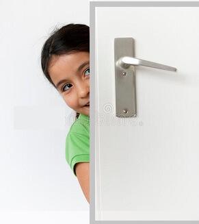 girl is hiding behind door.jpg