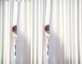 girl  is hiding  behind Curtain.jpg